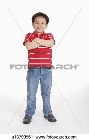 Stock Photography of Boy standing with hands on chest and smiling.