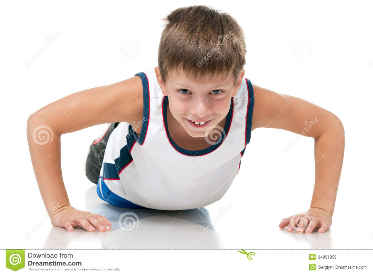 Training Young Athletic Boy Stock Photo.
