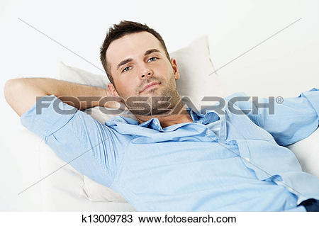 Stock Photo of Handsome man relaxing with hand behind head.