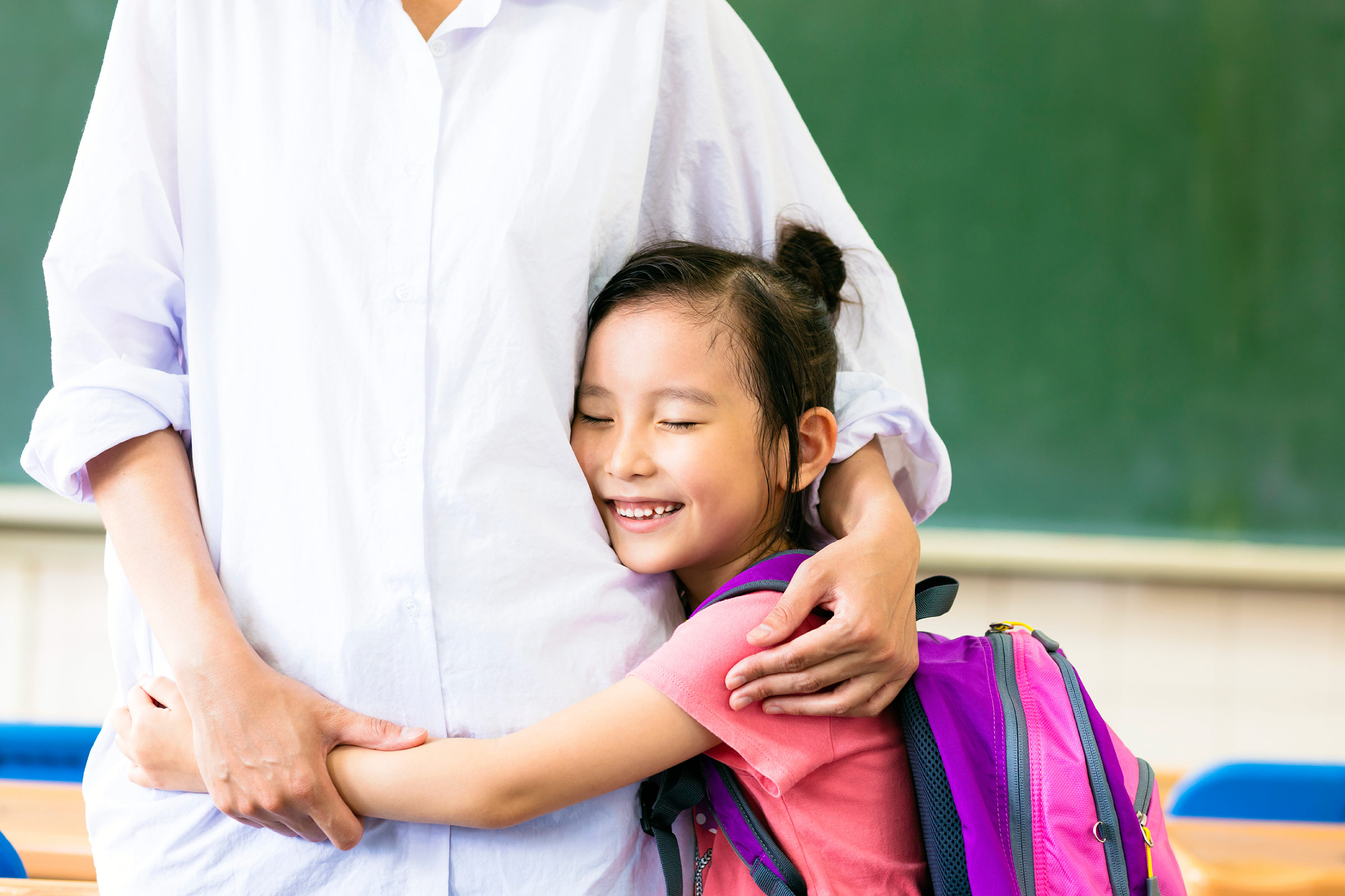 Happy Student And Teacher Hugging Clipart.