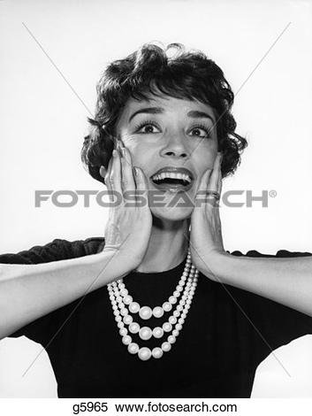 Stock Photo of 1950S Smiling Happy Woman Holding Hands Up Beside.