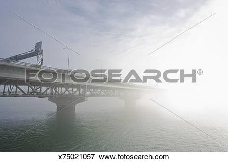 Picture of Early morning mist, Auckland Harbour bridge, Auckland.
