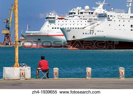Stock Image of Heraklion, Iraklio, Crete, Greece. Man fishin in.