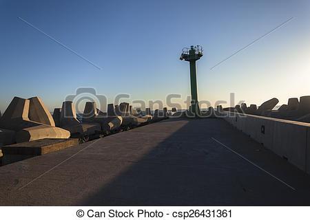 Stock Image of Harbor Entrance Pier Beacon.