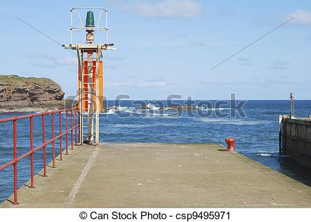 Stock Photography of Eyemouth harbour entrance and light on pier.
