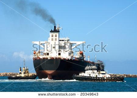 Tug Boats Guiding A Cargo Ship Out Of A Harbour Entrance Stock.