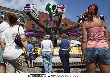 Stock Photo of England, Bristol, Bristol. People at a funfair.