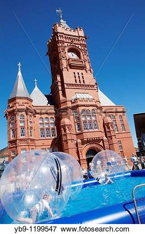 Picture of Children playing in giant air bubbles outside the.