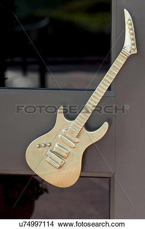 Stock Photo of Sculpture of guitar on the door of Hard Rock Cafe.