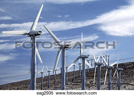 Stock Image of Modern WINDMILLS harness the wind to create.