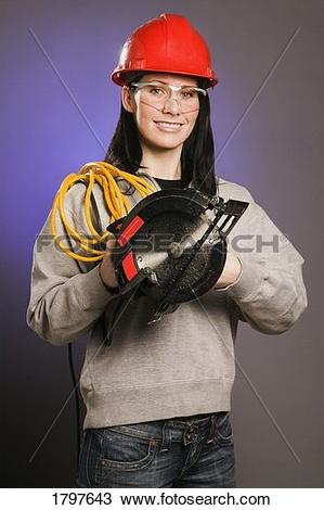 Stock Photo of Tradeswoman with extension cord and electric saw.