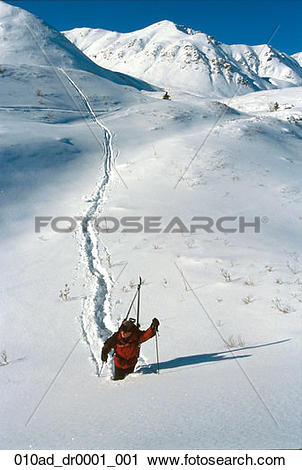 Stock Photography of Skier Climbing Up Hill in Deep Snow Hatcher.
