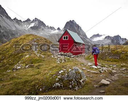 Stock Photography of Man hiking towards Mint Hut, Talkeetna.