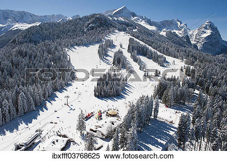 "Stock Image of ""Skiers on Hausberg Mountain, winter landscape."