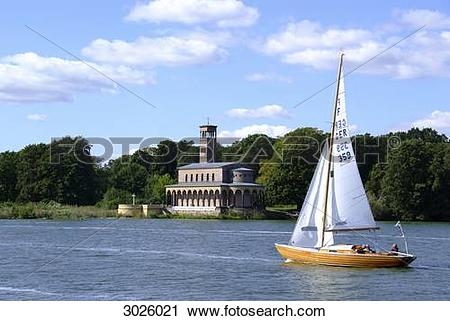 Stock Photography of Church at the bank of the Havel River, boat.