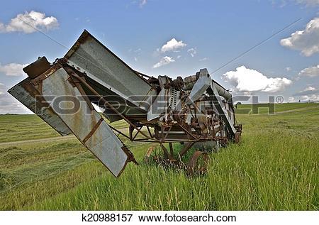 Picture of Threshing machine in hay field k20988157.