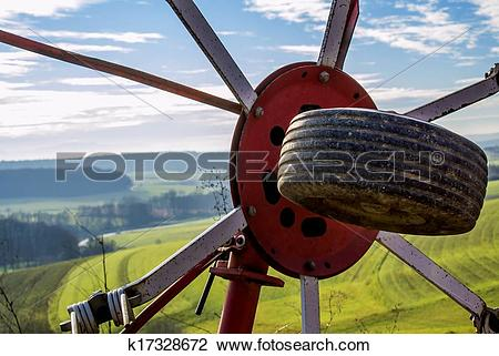 Stock Photo of panoramic view through a hay turning machine.