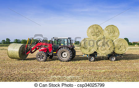 Stock Photographs of Hay harvesting machine.