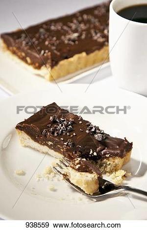 Stock Photograph of Piece of Chocolate Hazelnut Tart with.