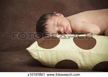 Stock Photography of A newborn baby with his head turned to one.