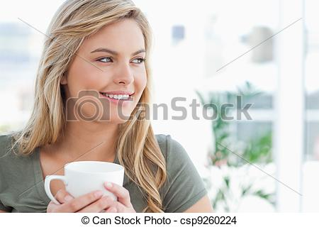 Stock Photo of Woman with her head turned to the side and a mug in.