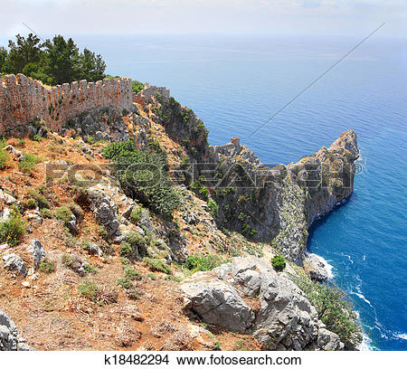 Stock Photo of rocky headland in sea and fortress wall in Alanya.