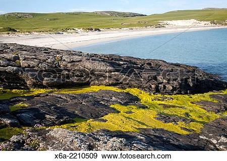 Stock Photograph of Rocky headland and sandy beach at Bagh a Deas.