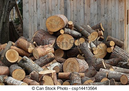 Stock Image of Firewood logs heaped in a pile.