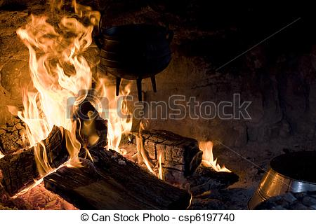 Stock Photography of Old Cast Iron Kettle Over Fire.