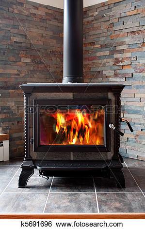 Stock Images of Burning Cast Iron Wood Stove Heating k5691696.