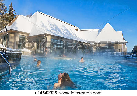 Stock Image of People bathing in a heated swimming pool in winter.