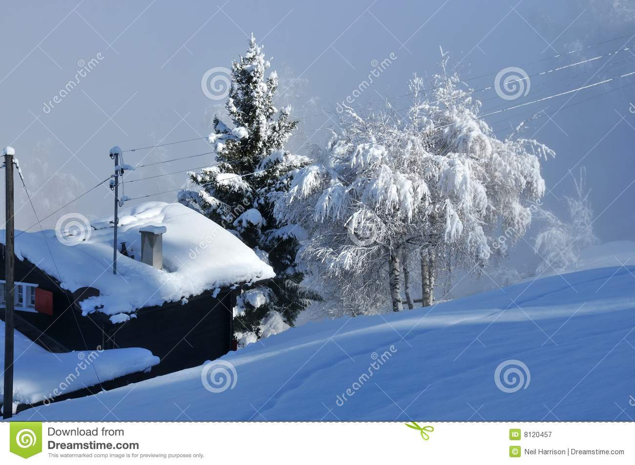 Heavy Snow On A Log Cabin Royalty Free Stock Photography.