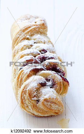 Stock Photo of Close up pastry with cherry jam filling and sugar.