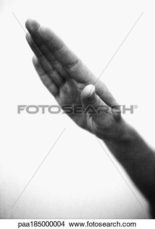 Stock Photo of Hand making heil sign, close.