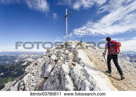 "Stock Photography of ""Mountaineer at the summit cross of Mt."