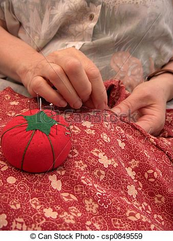 Stock Photographs of Women sewing a hem csp0849559.