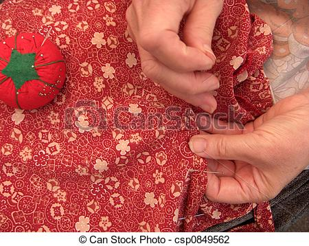 Stock Photo of women sewing a hem.