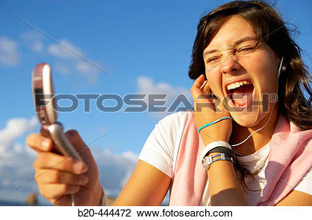 Stock Photo of 16 years old teenager listening to music in a MP3.