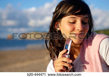 Stock Photography of 16 years old teenager listening to music in a.