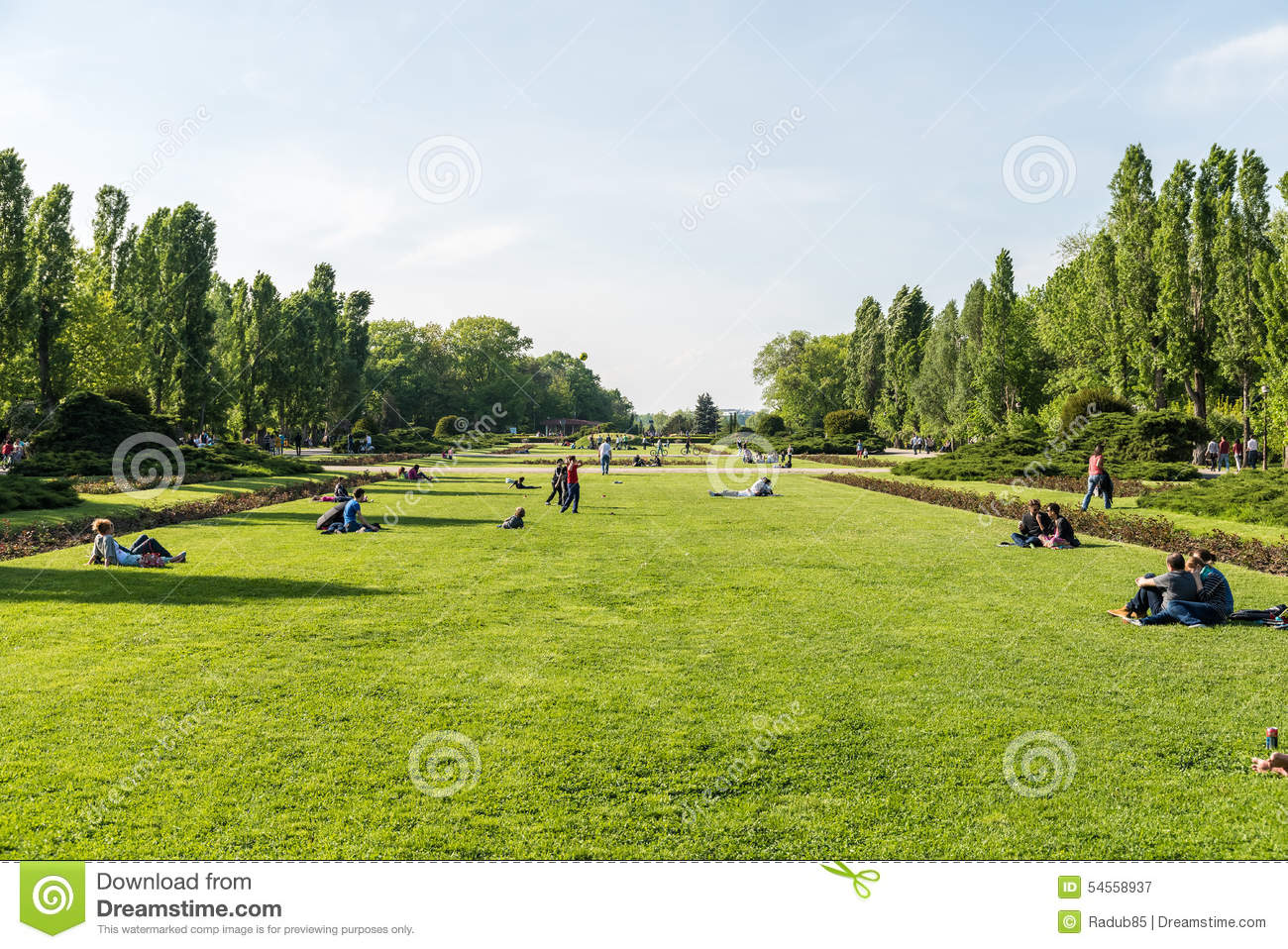 People Having Picnic And Playing Games In Herastrau Public Park.