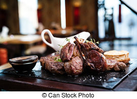 Stock Photography of New York steak with herb butter on a plate.