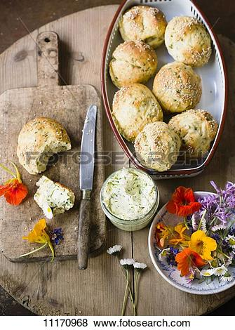 Pictures of Herb rolls with herb butter and edible flowers.