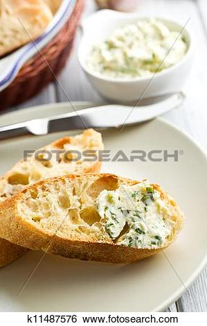 Stock Illustration of ciabatta with herb butter k11487576.
