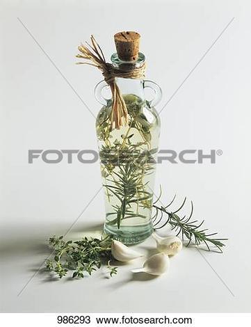 Stock Photo of Herb vinegar in a bottle 986293.