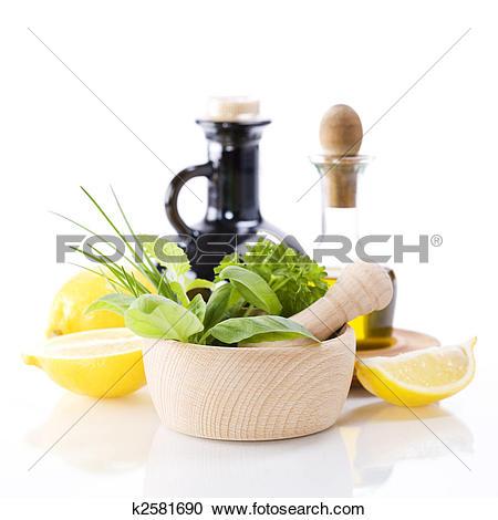 Stock Photography of Olive oil, vinegar, Healing herbs and lemon.