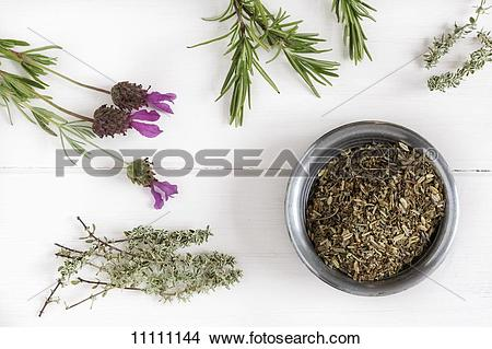 Stock Photo of Herbs de Provence in a bowl surrounded by fresh.