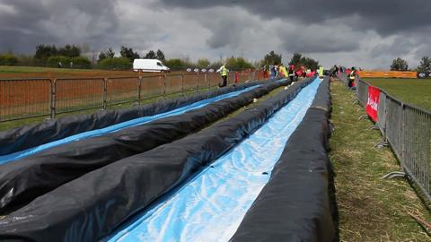 Watch hundreds enjoy giant waterslide at Herrington Country Park.