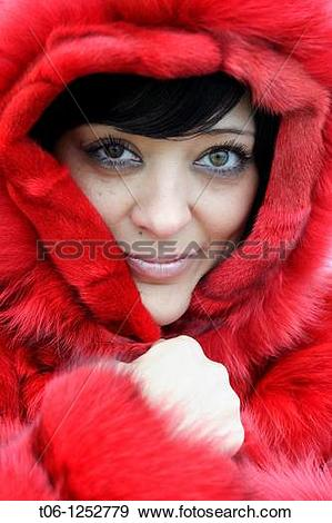 Stock Photograph of Woman with two different colored eyes and red.