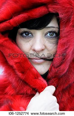 Stock Photo of Woman with two different colored eyes and red coat.
