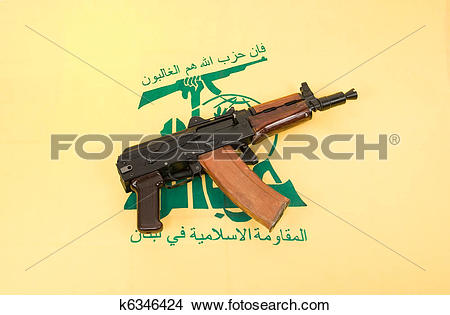 Stock Photo of Automatic rifle and flag of Hezbollah k6346424.